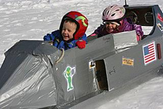 close-up of kids in sled